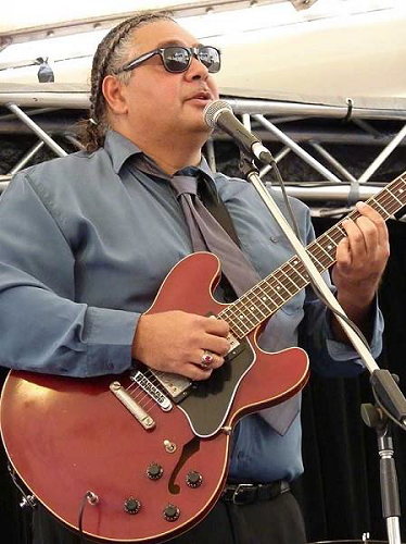 Image: Musician Buddy Knox is renowned for his ability to play authentic blues guitar on his cherry red 335 Gibson. (Image source: Buddy Knox Blues Band).