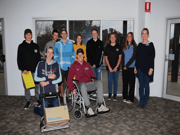 Image: TAFE's Amanda Morris (right) with participants in the youth manual handling training.