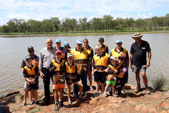 Image: Deputy mayor Anthony Michael joins members of Inverell RSM Fishing Club with a release of Murray Cod fingerlings at Lake Inverell