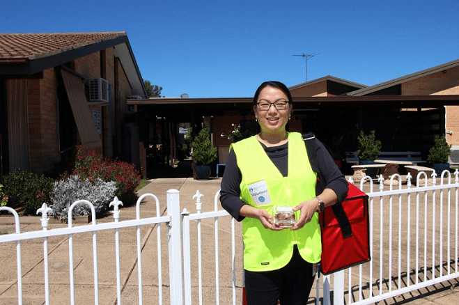 Image: Inverell Library's Maria Mutimer at Cooinda aged care units, with her next Meals on Wheels delivery.