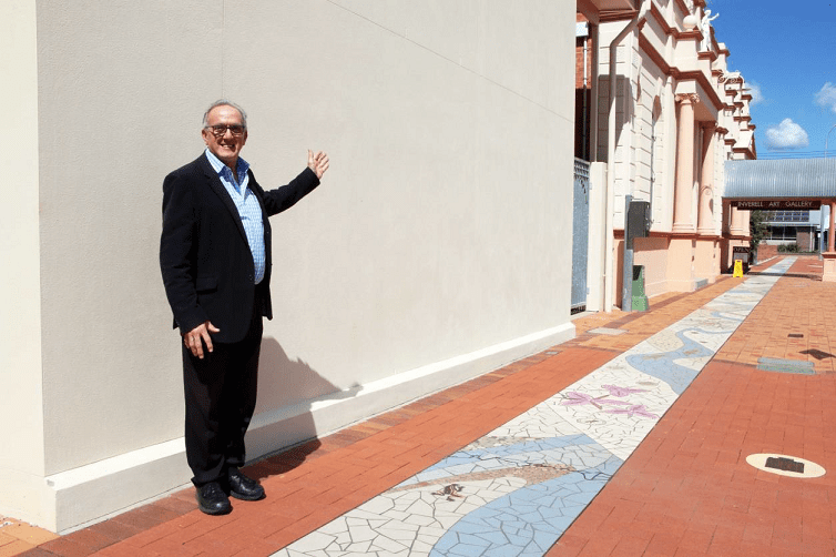 Image: Cr Anthony Michael in front of the blank canvas in Evans Street, Inverell